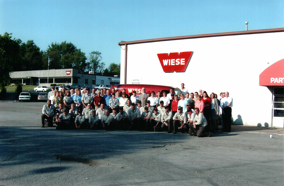 Wiese Staff Pose For Photo In Front Of Building